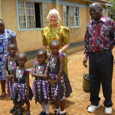 Nangina Head Teacher with pupils